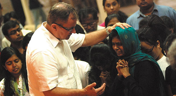 Lee Grady prays for a woman in Bangalore India